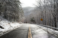 Cars on descent on the snowy mountain asphalt road with two lanes. Cars on descent on the snowy mountain asphalt road with two lanes Stock Photography