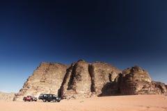 Cars in the desert. Wadi rum, jordan royalty free stock image