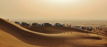 Cars in desert Stock Images