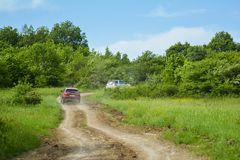 Cars on dirt road, rally stock images