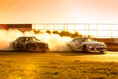 Cars are drifting at motordrome in the light of sunset. MOSCOW, RUSSIA - MAY 05, 2018: cars are drifting at motordrome in the light of sunset, first stage of royalty free stock photography