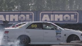 Cars Drifting with Smoke. Moscow, Russia - September 1, 2016 : Slow motion shot of cars drifting with lots of smoke during drift competition in Moscow, Russia on stock video footage