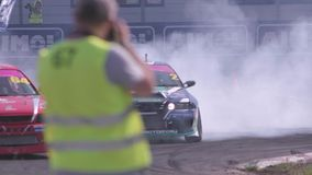 Cars Drifting with Smoke. Moscow, Russia - September 1, 2016 : Slow motion shot of cars drifting with lots of smoke during drift competition in Moscow, Russia on stock video