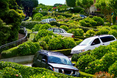 Cars drive down Lombard Street switchback in San Francisco CA Royalty Free Stock Photo