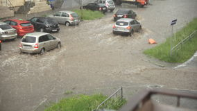 Cars drive on a flooded road in the rain, slow motion stock video footage