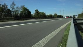 Cars drive on the German Autobahn.. stock footage