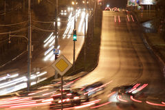 Cars drive on highway in the night city. Urban style Royalty Free Stock Photos