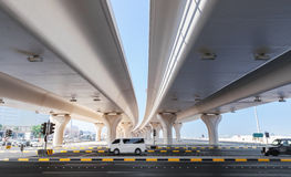 Cars drive on the highway under automotive bridges Stock Photos