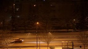 Cars drive at night in snow storm. Following cars drive at night in snow storm stock video footage