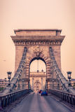 Cars Drive Over the Historic Chain Bridge in Budapest Stock Images