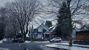 Road in suburbs on snowy winter day stock footage
