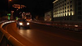 Cars drive by road junction bridge part urban city night. Stock footage stock video footage