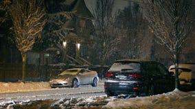 Cars Drive Through Suburbs In Snowfall stock footage
