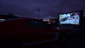 Cars in Drive-in theater watching film stock video