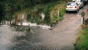 Cars Drive Through Waterway stock video