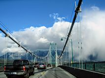 Cars driving across the Lions Gate Bridge, which crosses from Stanley Park to North Vancouver. stock image