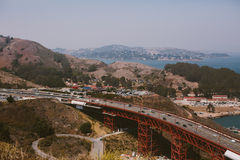 Cars Driving across Red Bridge Stock Photography