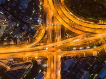 Cars driving on bridge roads shaped curve highways with skyscraper buildings. Aerial view of Expressway Bangna, Klong Toey in. Structure of architecture concept royalty free stock photography