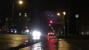 Cars driving on a city street at night stock video footage