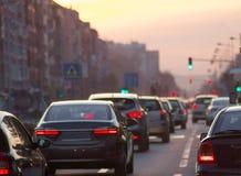 Cars driving on city street traffic jam Royalty Free Stock Photo