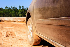 Cars driving on dirt roads with dust orange royalty free stock photo