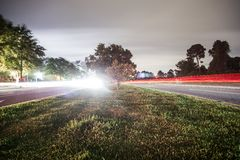 Cars. Driving down the road at night rn Royalty Free Stock Images