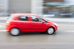 Cars Driving Fast in City Stock Photography
