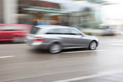Cars Driving Fast in City Stock Photos