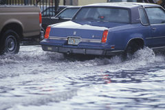 Cars Driving Through Flooded Street Royalty Free Stock Photography
