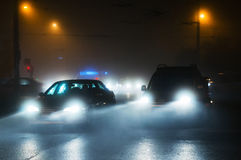 Cars driving in fog royalty free stock images