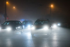 Cars driving in the fog at night Stock Image