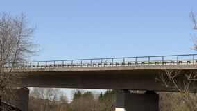 Cars ride on a high bridge bottom view. Cars driving on a high bridge bottom view, slow motion stock video