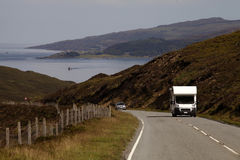 Cars driving in the highlands of Scotland Stock Photo