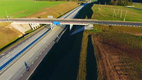 Cars driving on highway bridge. Aerial view road junction. Car bridge highway. Sky view car bridge over highway road. Cars traffic on highway intersection. Cars stock video
