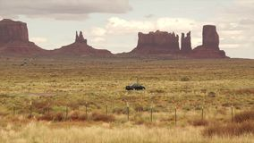Cars Driving Through Monument National Park stock video