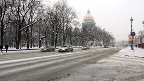 Cars driving near St. Isaac's Cathedral in winter Royalty Free Stock Photography