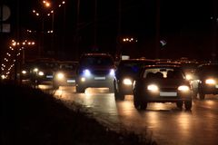 Cars are driving on night highway. Modern transport. Urban road Royalty Free Stock Image