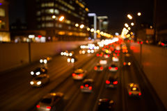 Cars driving on night road royalty free stock photo