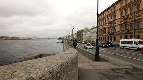 Cars driving on the road along the Neva River Stock Photos