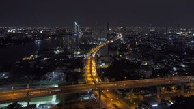 Cars driving on roads and highways in Bangkok City at night in transportation concept, Thailand.  stock footage