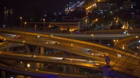 Cars driving on roads and highways in Bangkok City at night in transportation concept, Thailand.  stock video