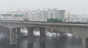 Cars driving on a snowy day at Essingeleden, a motorway in central Stockholm Royalty Free Stock Photo