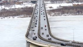 Cars driving on snowy road in winter, traffic driving on the bridge, highway. 1 stock video