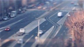 Cars driving, tilt shift in Bucharest stock video