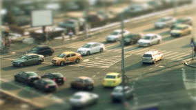 Cars driving, tilt shift in Bucharest stock video footage