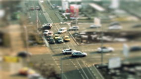 Cars driving, tilt shift in Bucharest. Cars driving in the city, high traffic during the day, tilt shift stock video footage