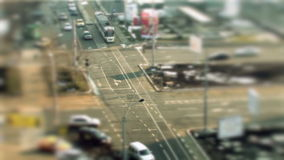 Cars driving, tilt shift in Bucharest. Cars driving in the city, high traffic during the day, tilt shift stock video