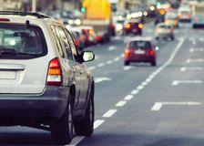 Cars driving traffic jam. In city stock photo