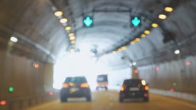 Cars driving in the tunnel bokeh background. 4k, 3840x2160. Cars driving in the tunnel bokeh background stock video footage