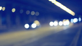 Cars Driving In A Tunnel. At night with bokeh stock footage